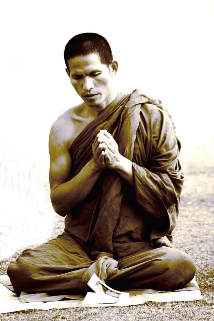 A buddhist by the book. Sarnath, Uttar Pradesh, India.