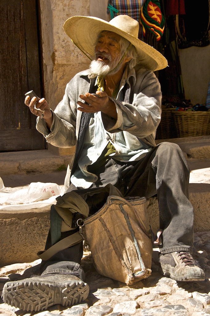 The old miner offering artefacts.