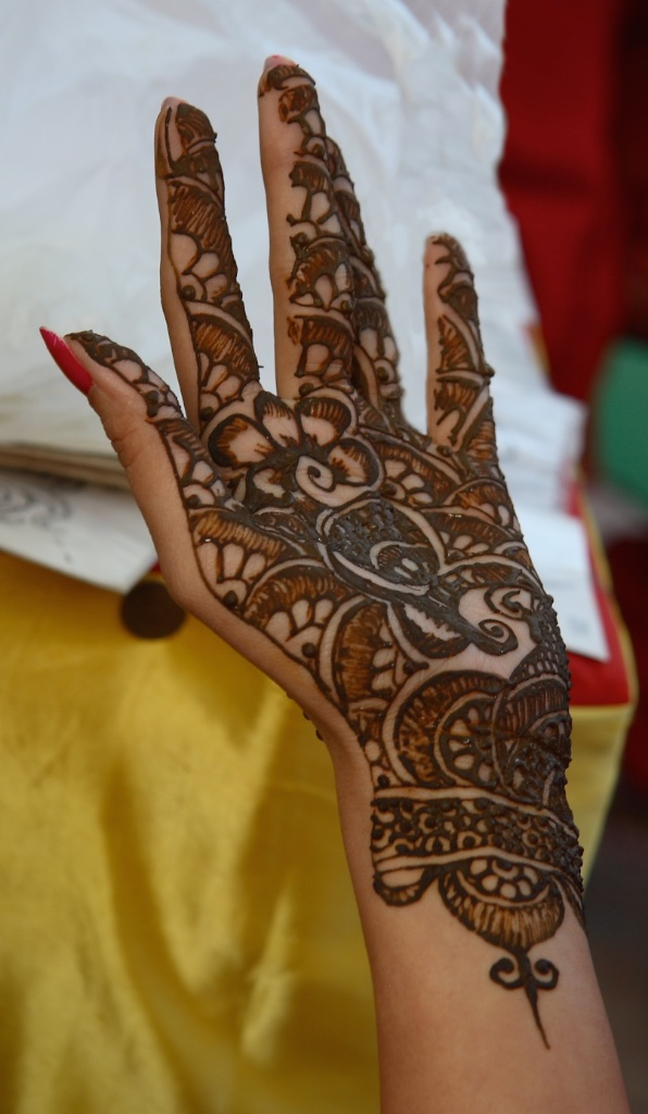 Henna-designed hand that mustn't be spoiled by manual work.