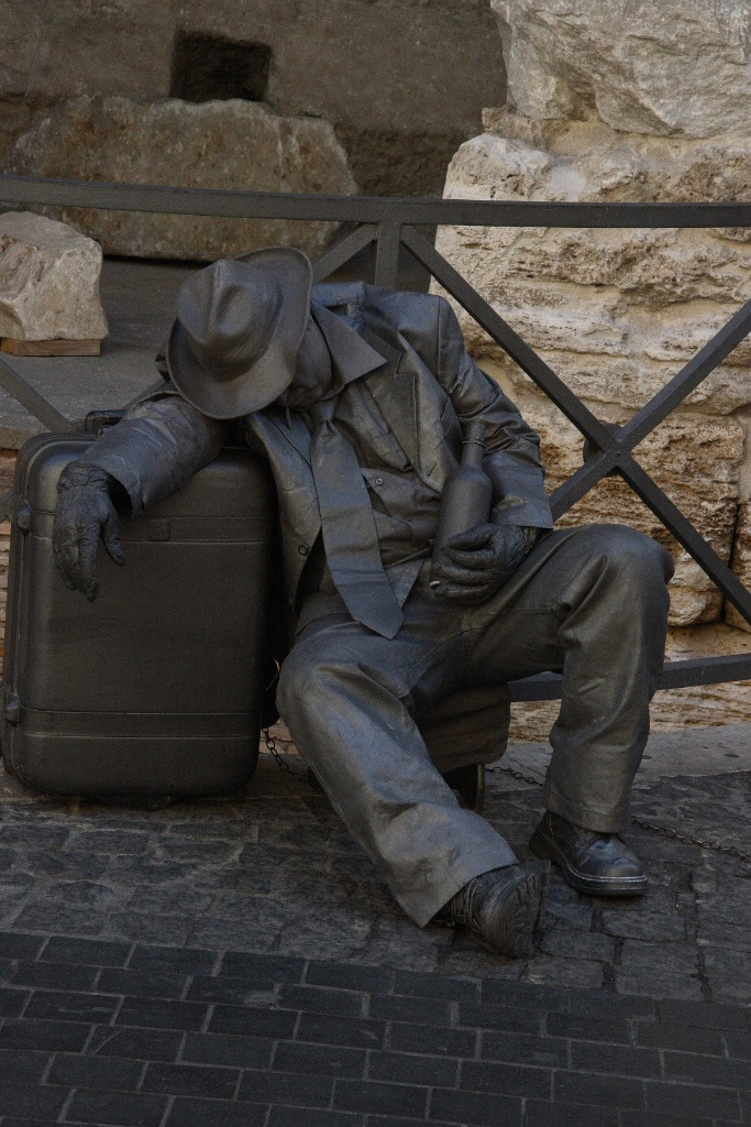 The bottle man and his baggage. Rome, Italy.