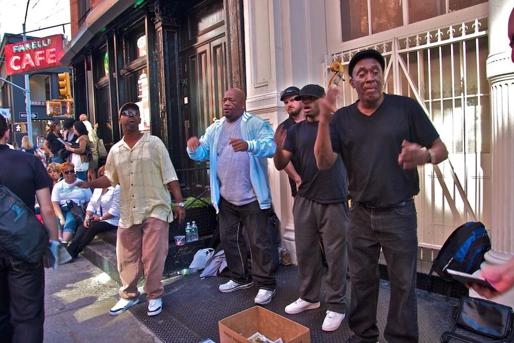 The barbershop band on the corner.