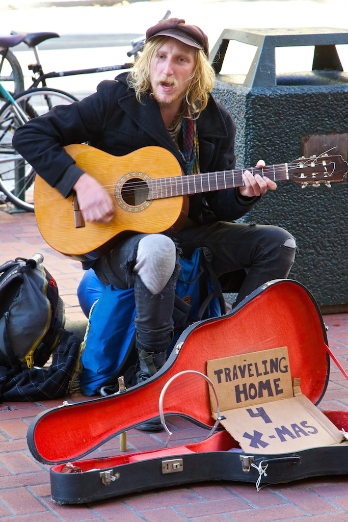 Strumming for the home-going fare.