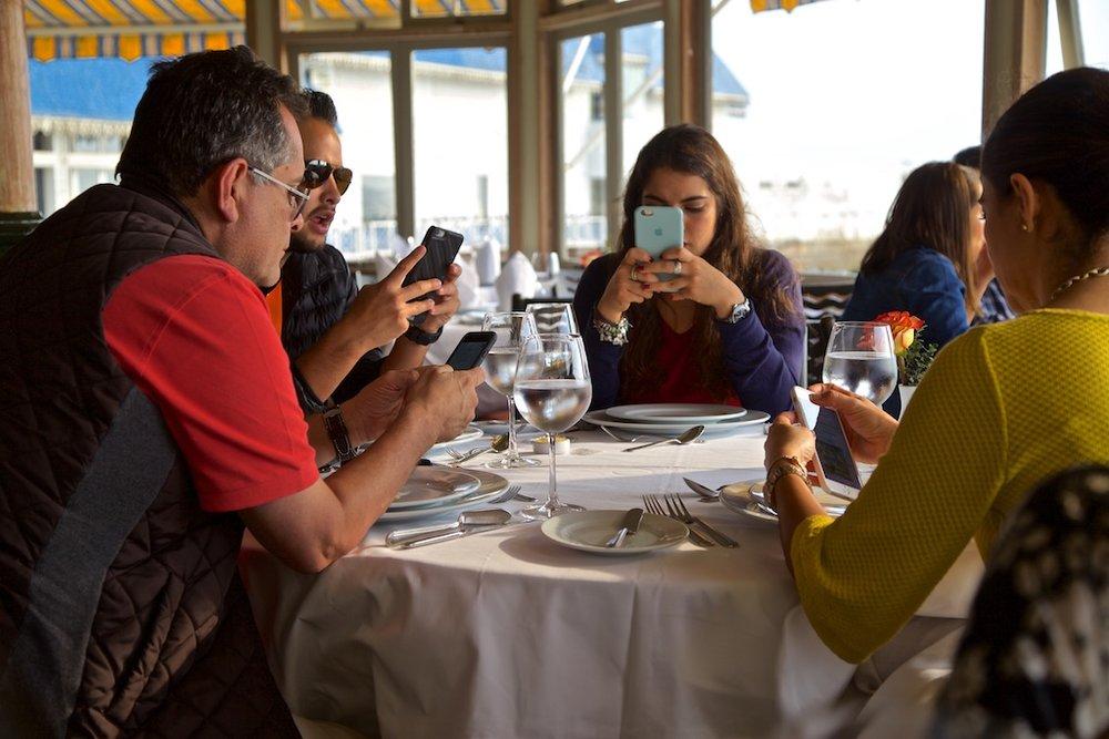 Sending messages across the table. Miraflores, Peru.