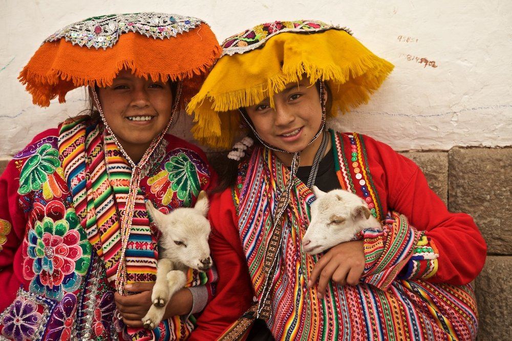 Girls with their pets, Cusco, Peru