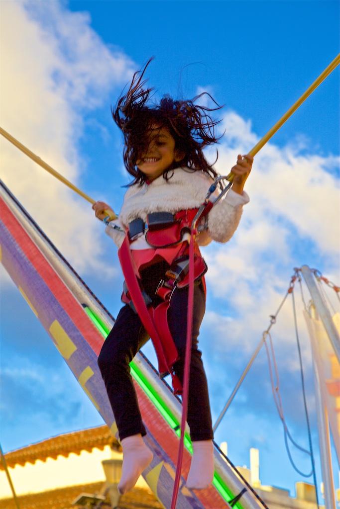 - Children: Enjoying the lack of gravity at a fun fair. San Cristobal de las Casas, Mexico.