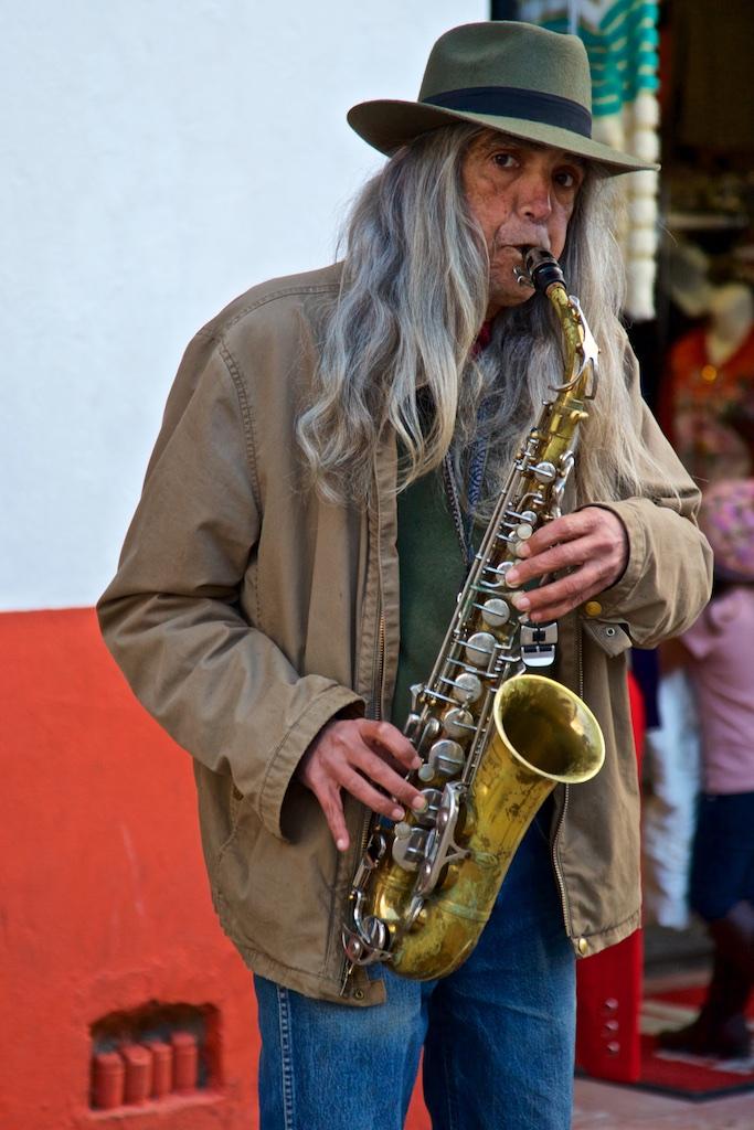 - Street Entertainment: A hippie survivor whose instrument has also seen better days.