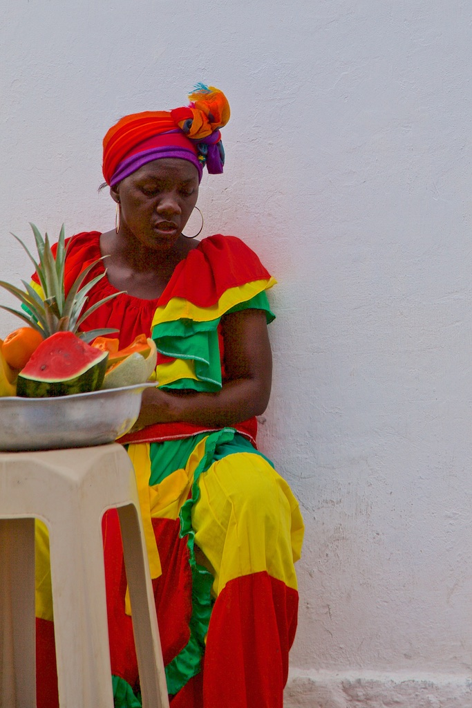 - People, Customs & Crafts: Local vendor of fruits matching her outfit. Cartagena de Indias, Colombia.