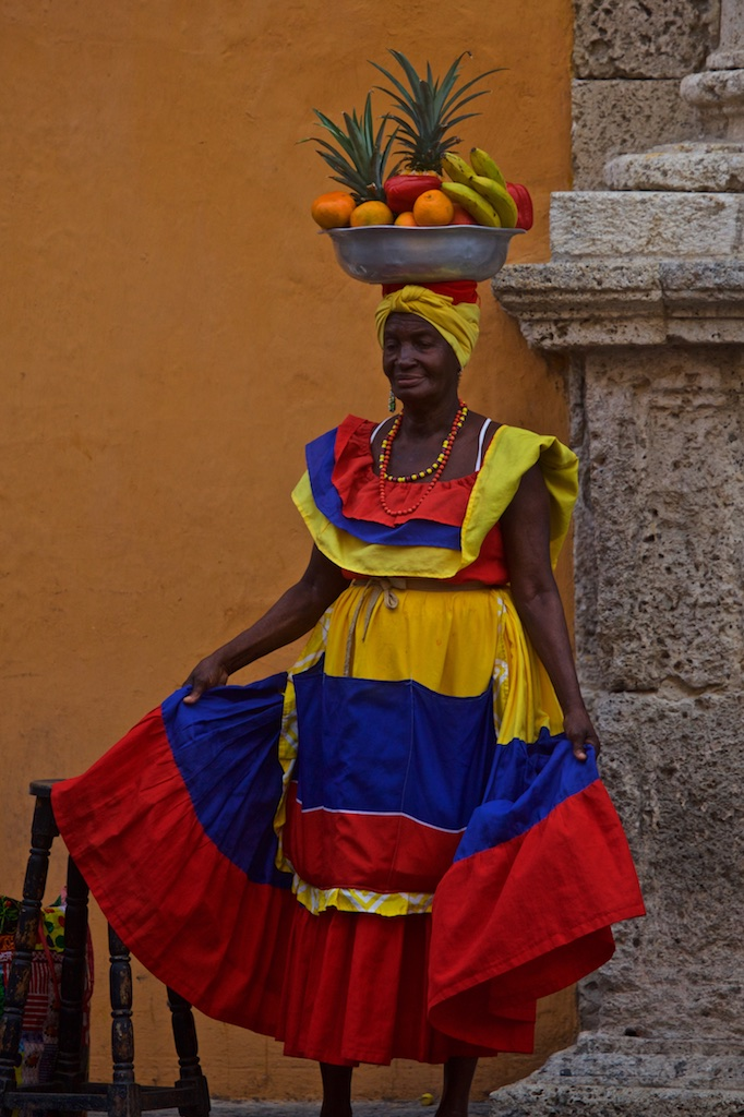 - People, Customs & Crafts: Looking her prettiest with an inventive hat to match. Cartagena de Indias, Colombia.