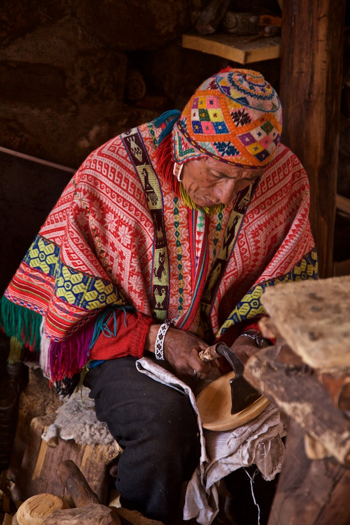 - People, Customs & Crafts: A local craftsman working on a piece of wood. Awana Kancha, Peru.