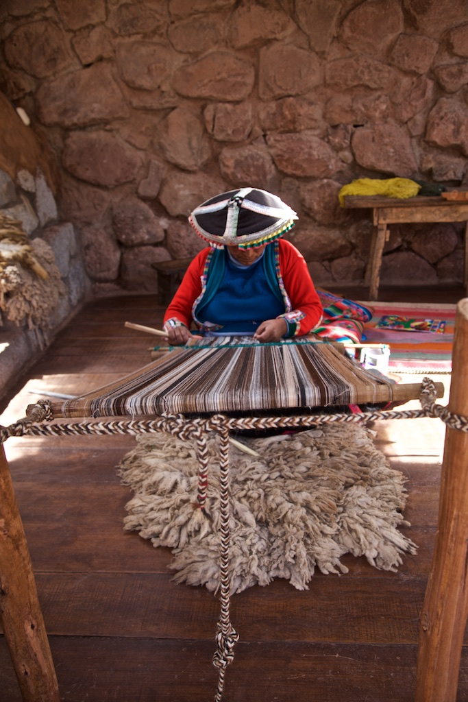 - People, Customs & Crafts: A traditional weaver of llama wool.