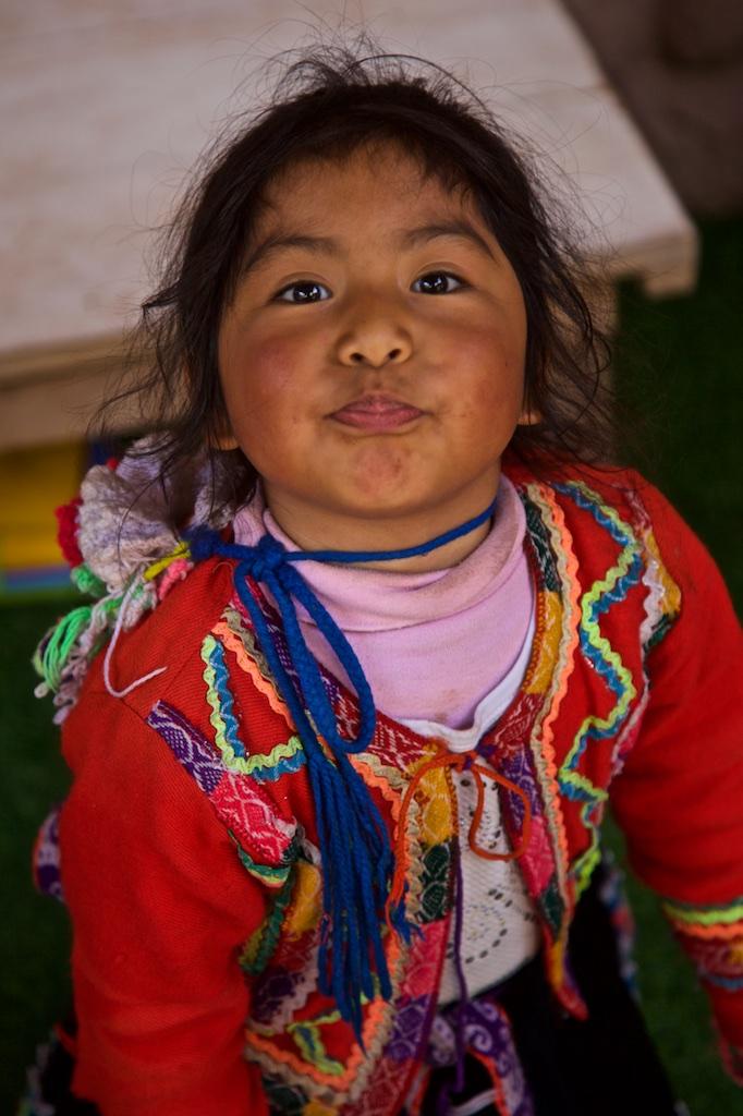 - Children: Defiance. Awana Kancha, Peru.