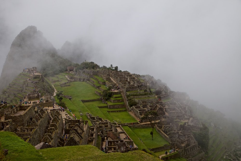 - Places & Spaces: Machu Picchu, abandoned by the Inka people centuries earlier, here enveloped by fog atop an inaccessible rock.