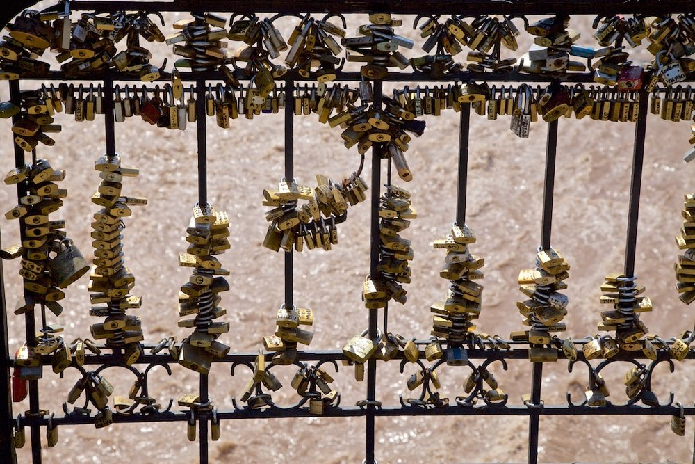 - Passion: Locks of love, of the metallic kind, on the bridge over a raging river. Santiago de Chile.