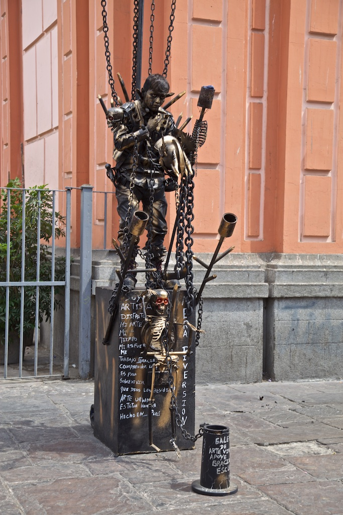 - Street Entertainment: A grim presentation in chains. Lima, Peru.