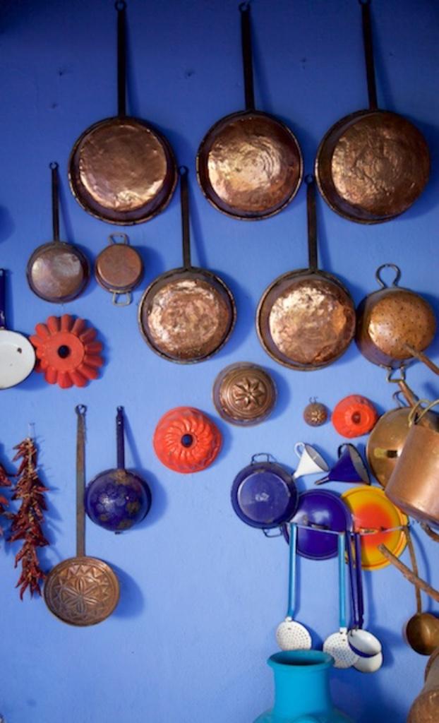 Pots and pans on a wall at Su Gologone, Sardinia.