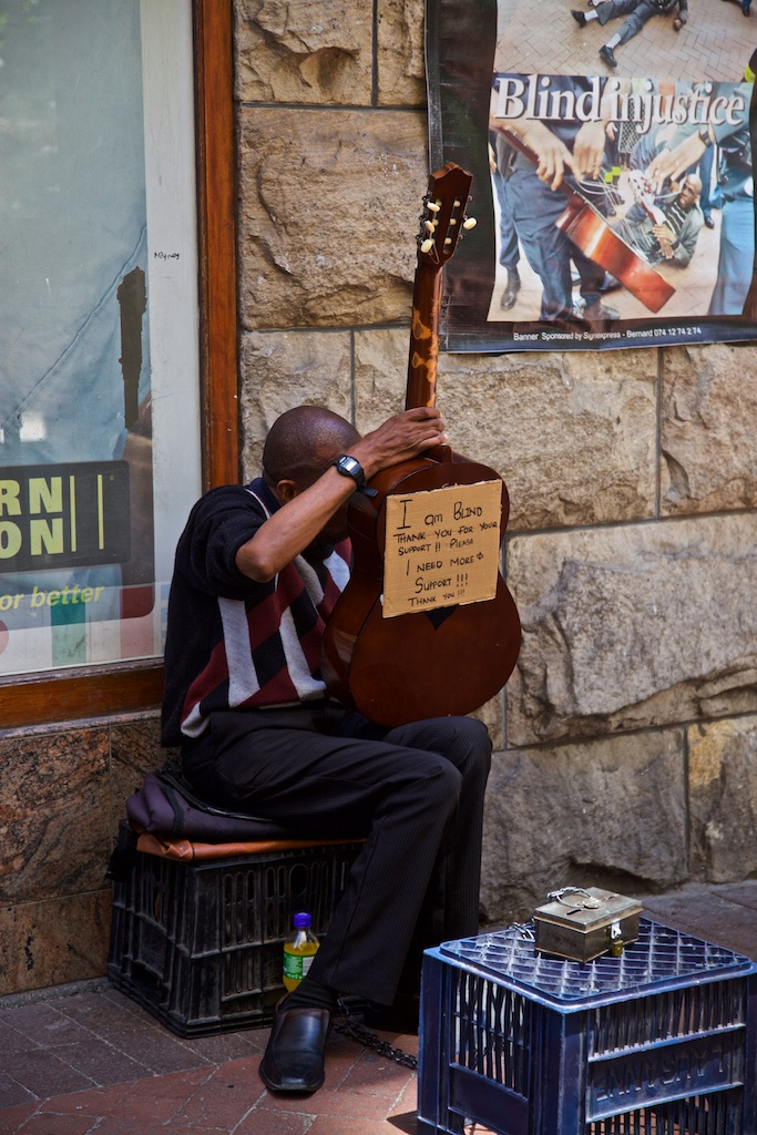 A blind man's approach to solve guitar playing by reversing it. Cape Town, South Africa.