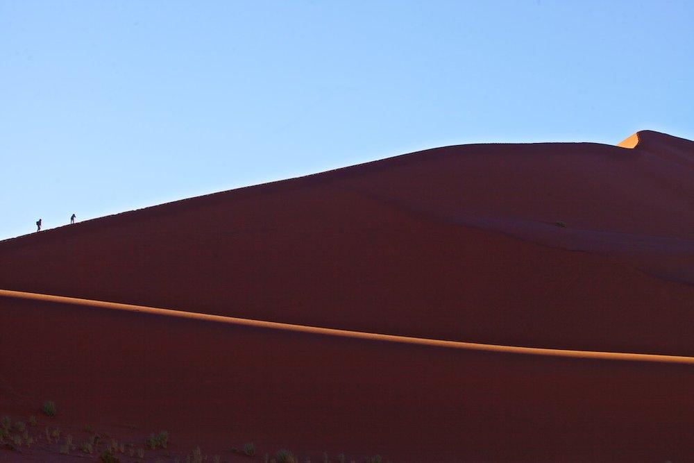 "Climbing the 325-metre ""Big Daddy"" sand dune in Sossusvlei, Namibia"