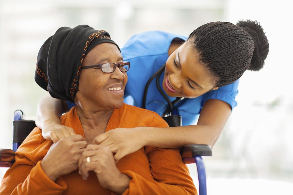 african-senior-patient-with-female-nurse-000040483622_Full.jpg