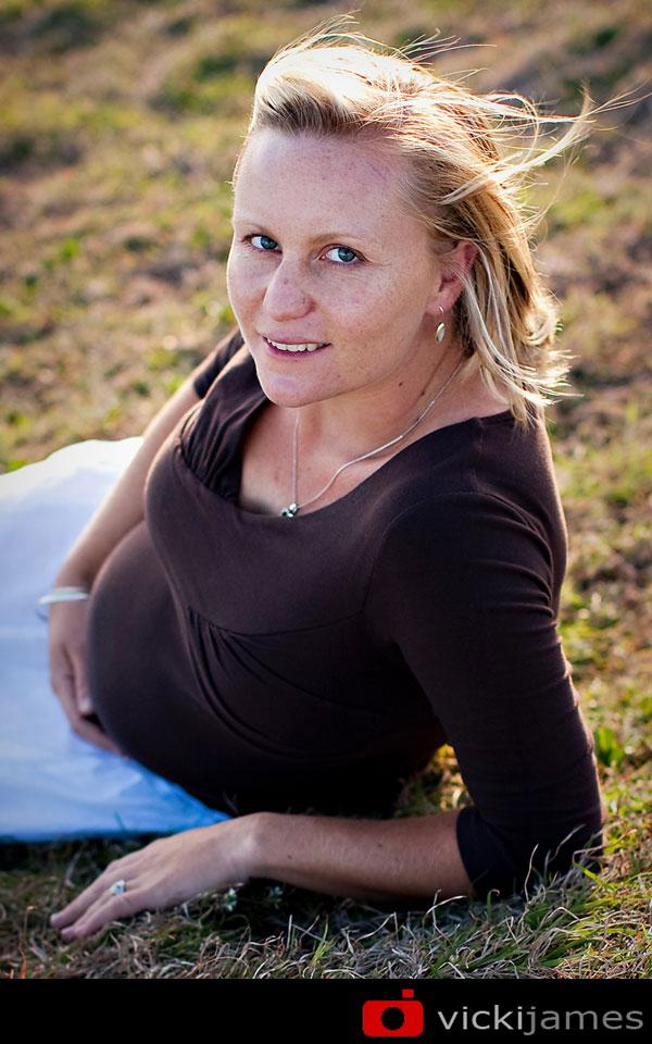 pregnant lady lying on hillside