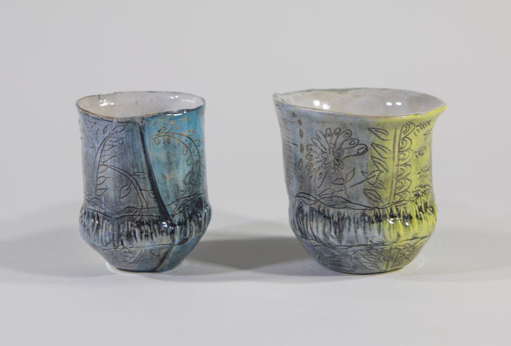 "Cup I & II  2018 Glazed ceramic cup on right:  4""h x 4""w x 12""d"