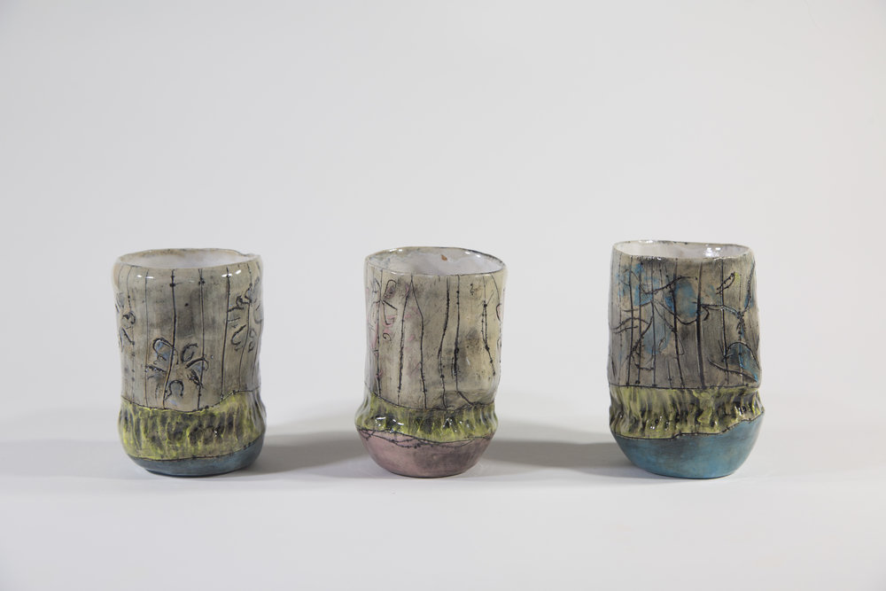 """Tricolor Cup Series  2018 Glazed ceramic cup in middle:  4""""h x 4.5""""w x 10""""d"""