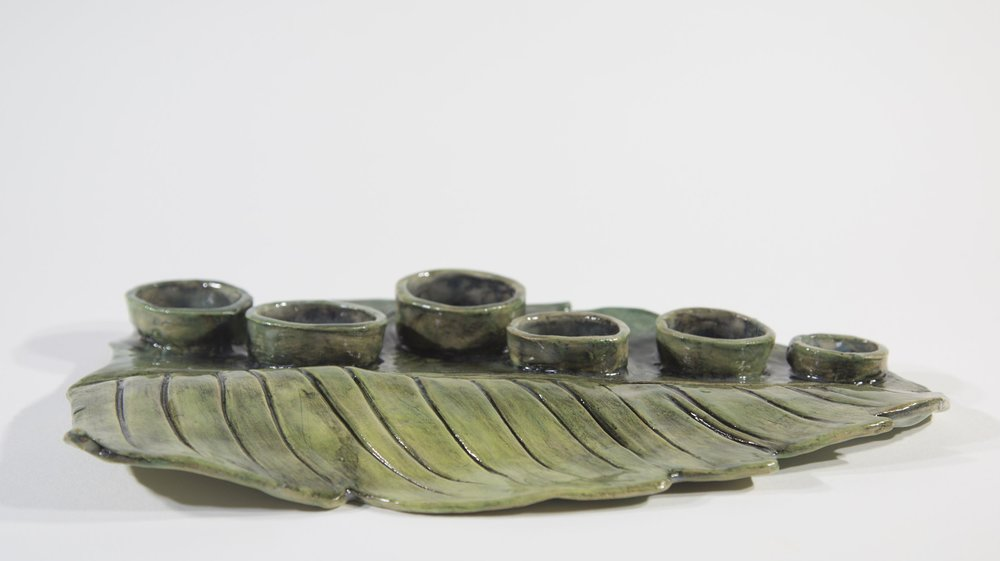 """Onam Plate   2018  Glazed ceramic 14""""L x 8.5""""w x .25"""" thick"""