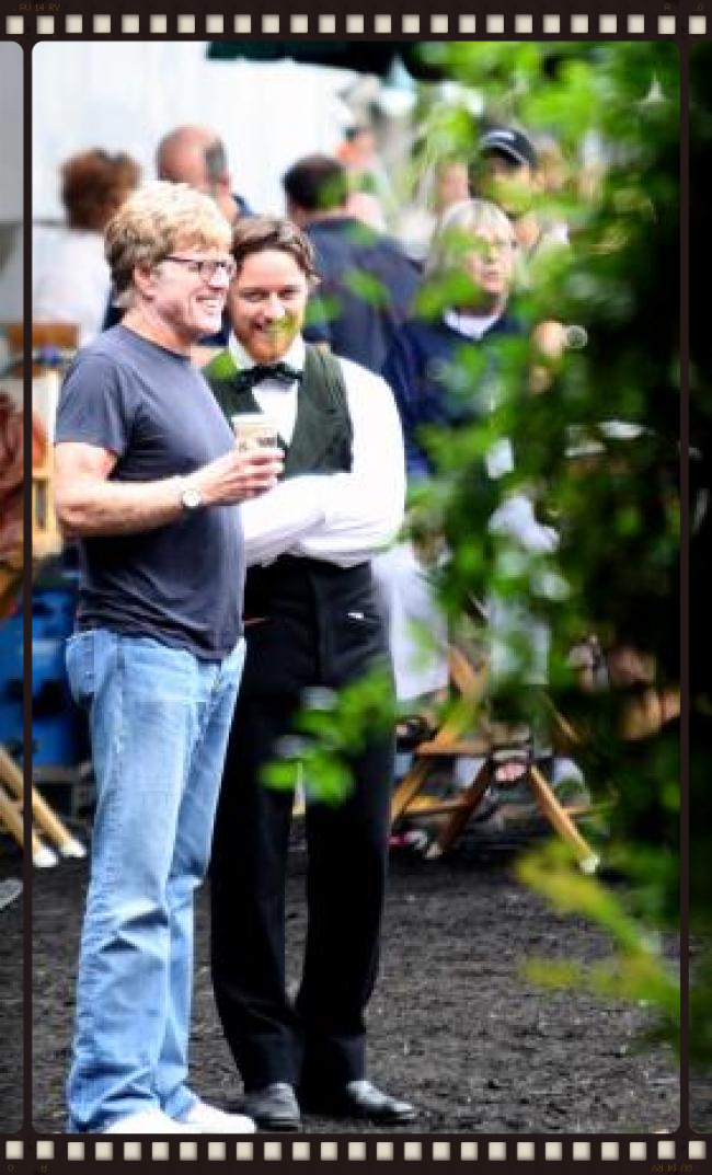 Robert Redford takes a break with James McAvoy during the filming of The Conspirator on Madison Square.