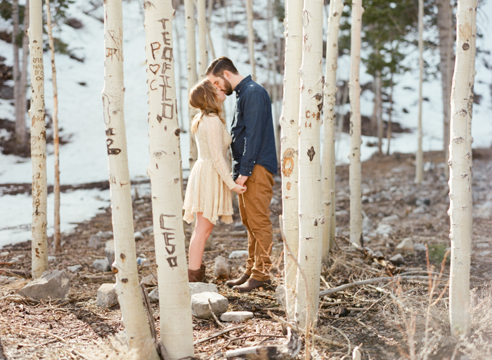 snowy aspen trees engagement session