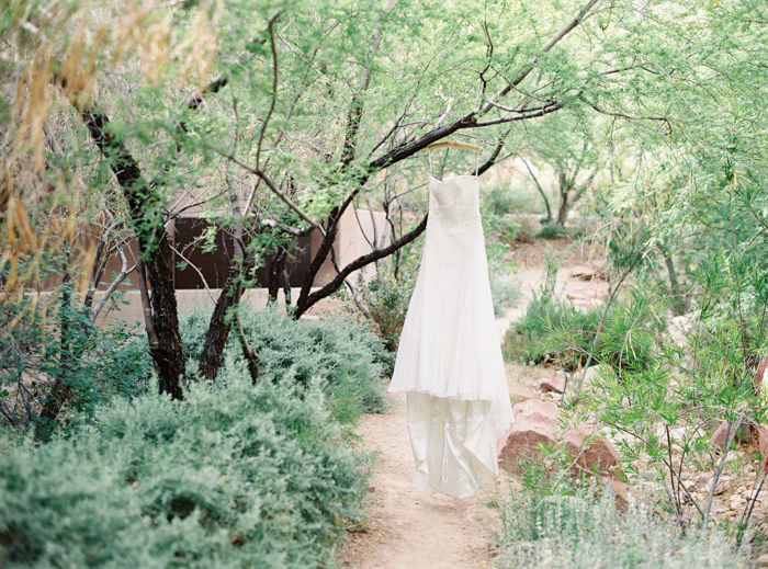 wedding dress hanging in the garden