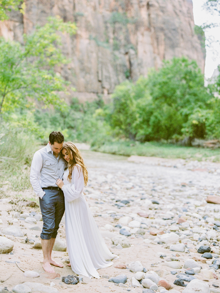 engagement photo in the river