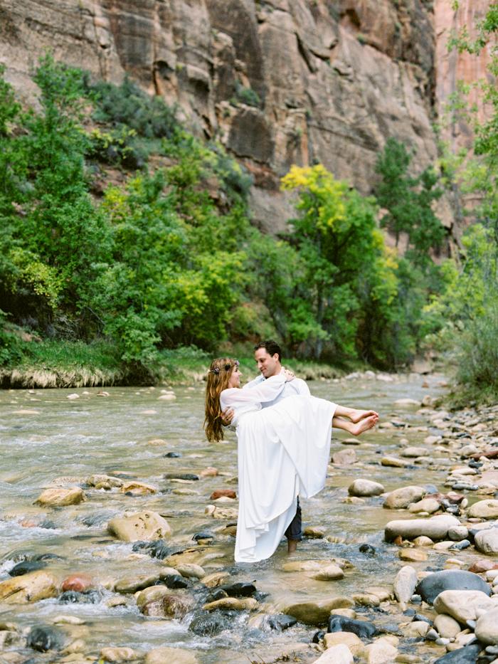 romantic zion national park river engagement photo