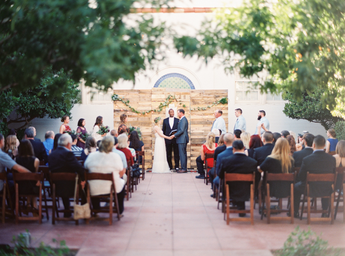 las vegas wedding with boho details reclaimed wood ceremony backdrop