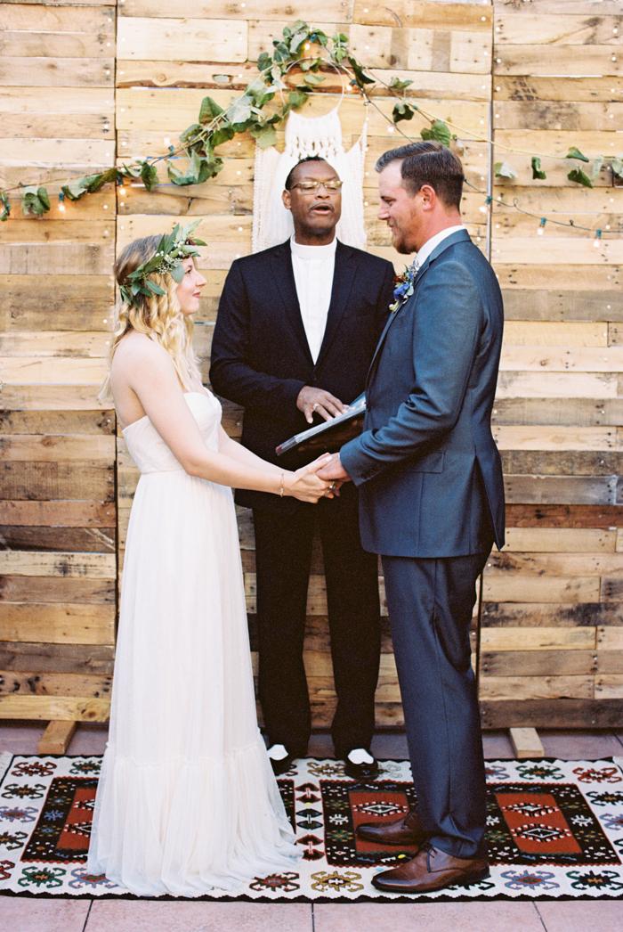 las vegas wedding with boho details photo reclaimed wood backdrop
