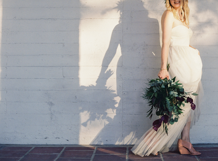 bhldn wedding dress and eucalyptus bouquet