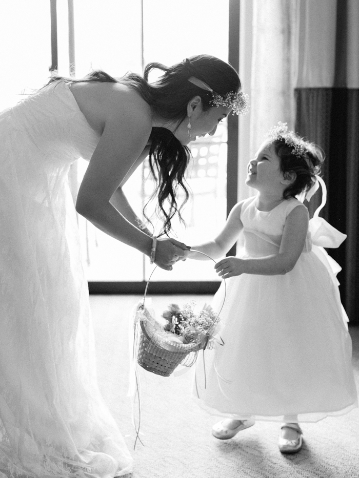 flower girl and bride looking at each other | gaby j photography
