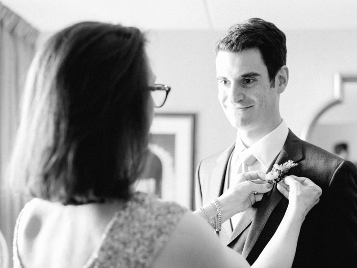 mom putting on son's boutonniere | gaby j photography