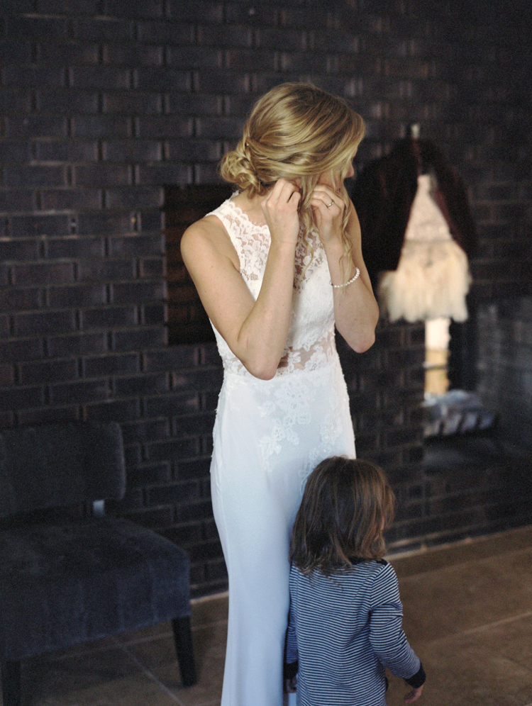 daughter watching mom get ready before wedding ceremony | gaby j photography