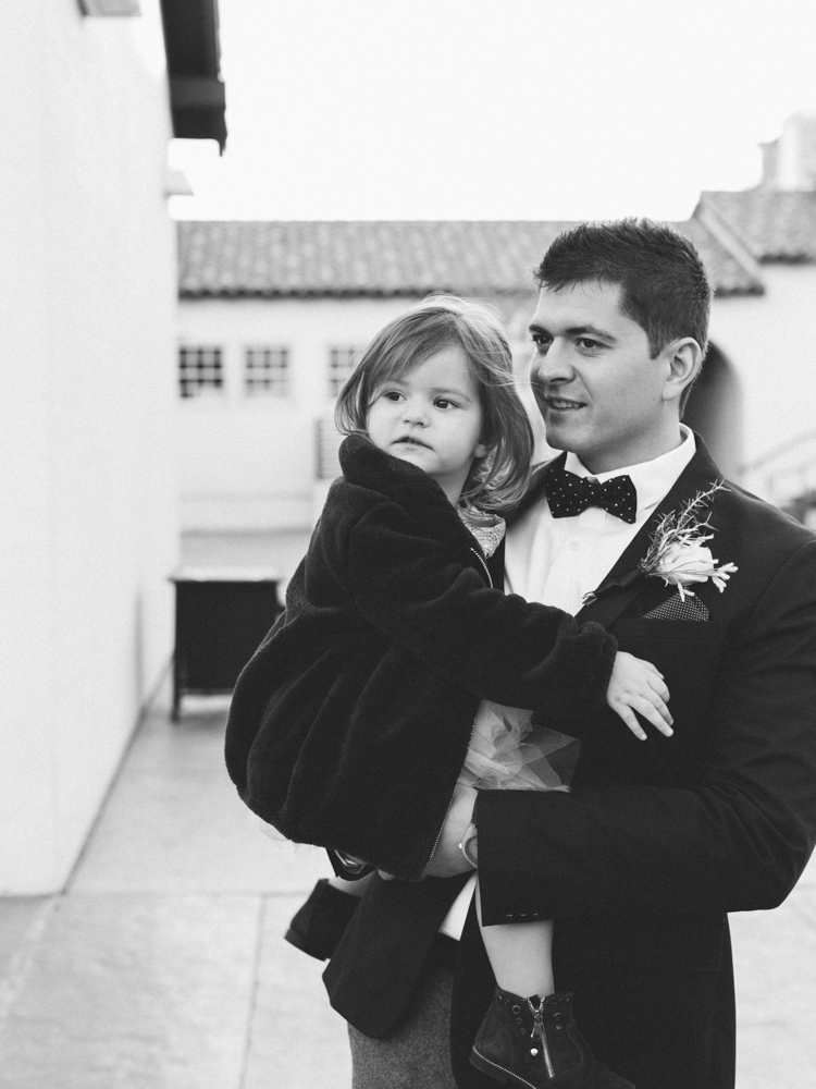 historic fifth street school wedding | gaby j photography | las vegas wedding photographer | family gathering winter wedding inspiration | dad holding daughter