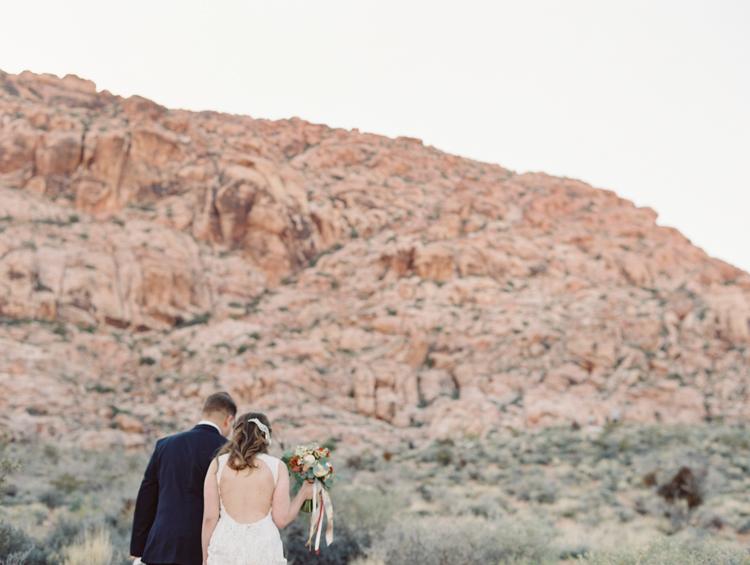 small wedding at red rock canyon national park | desert elopement | gaby j photography | las vegas elopement | danani handmade adornments | opal floral
