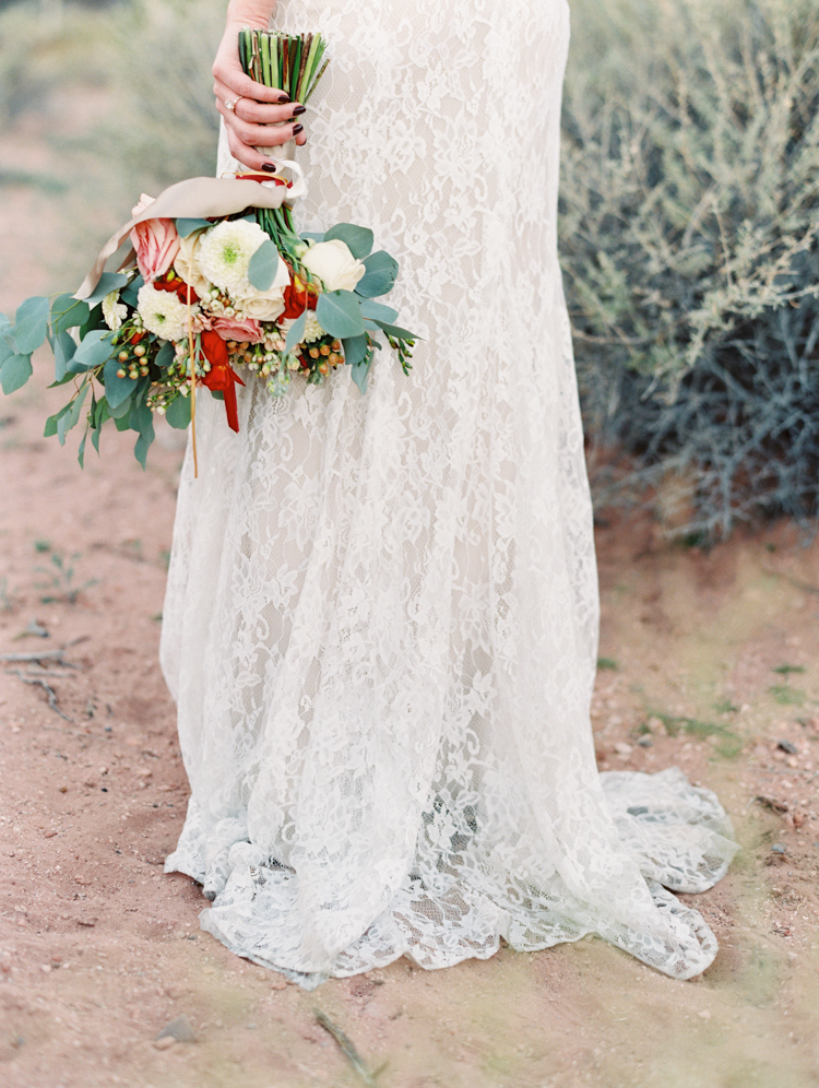 small wedding at red rock canyon national park | desert elopement | gaby j photography | las vegas elopement | dreamnette bridal | badgley mischka | opal floral las vegas