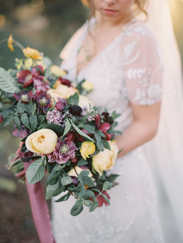 english garden inspired wedding bouquet magentas purples yellows
