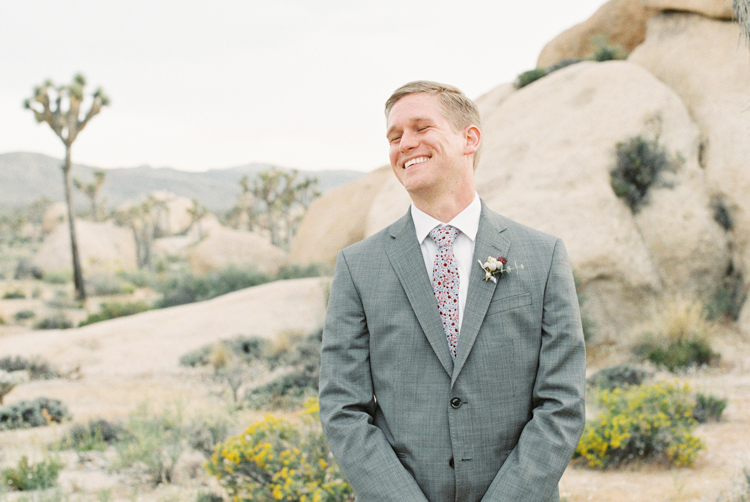 groom seeing bride for the first time smile
