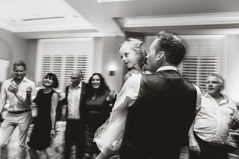 dad dancing with daughter during wedding