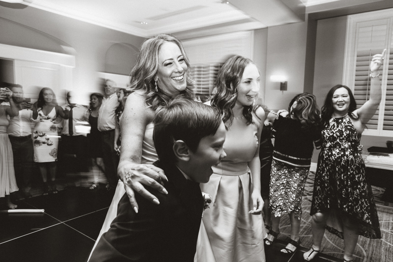 mom dancing with children wedding