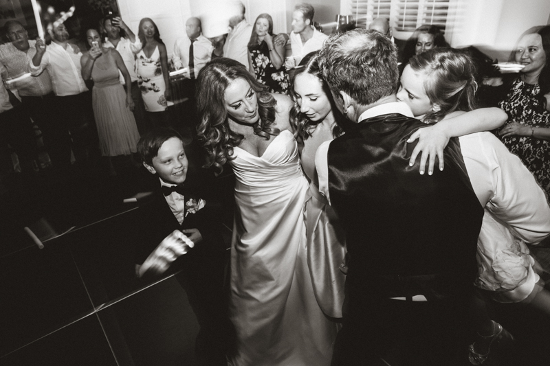 family dancing together during wedding reception