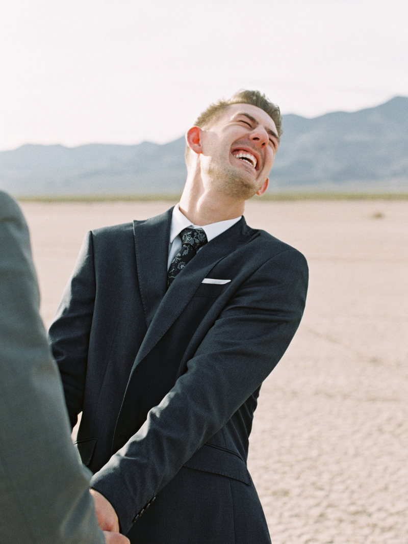 groom laughing during ceremony