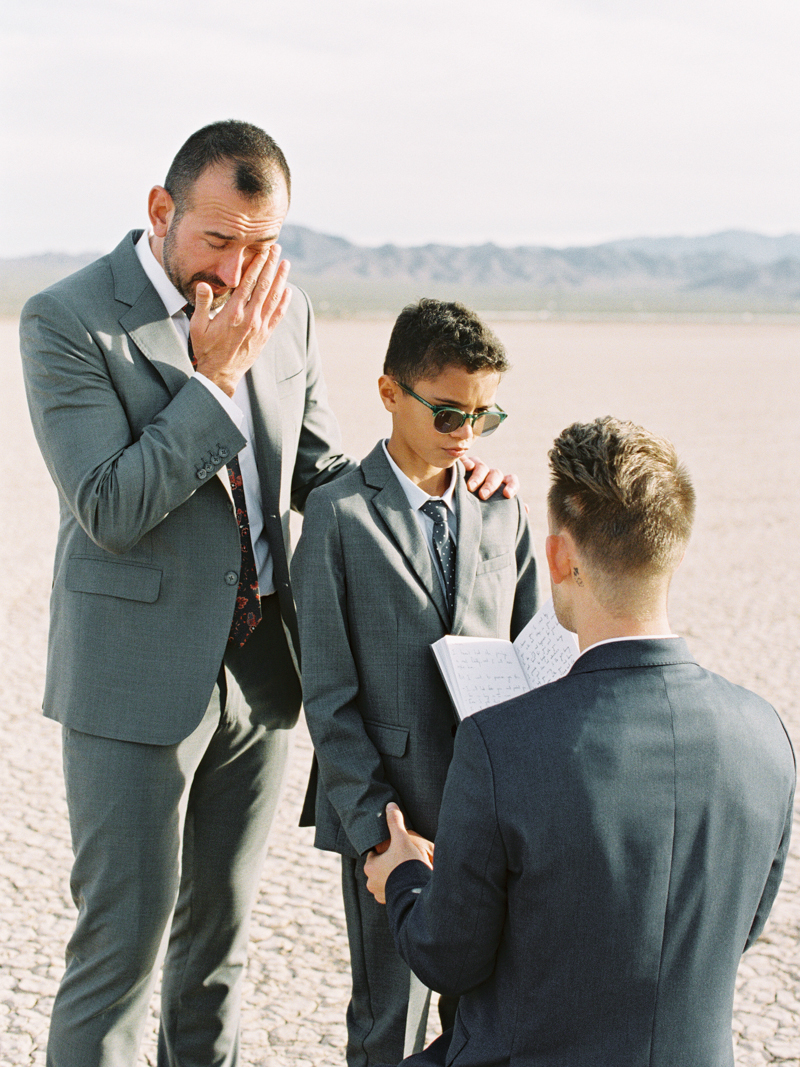 groom saying vows to step-son during wedding ceremony