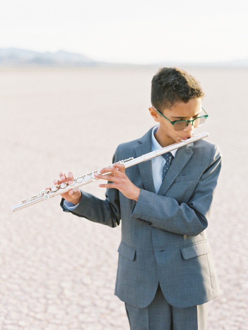 boy playing the flute during wedding ceremony