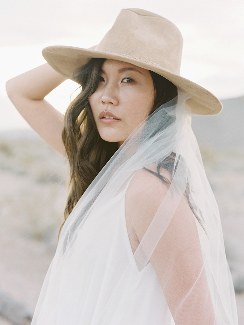 bride wearing cowboy hat and veil