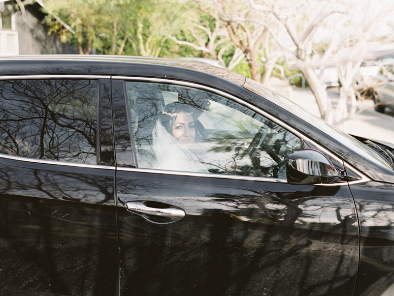 bride driving in car to wedding ceremony